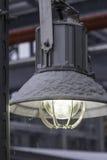 Street industrial led lamp under snow closeup Stock Image