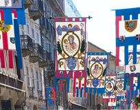Street Insignias. Armorial insignias on street of the city of Asti, displayed during the famous palio Royalty Free Stock Photos