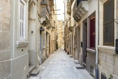 Street on the island of Malta. Typical narrow street on the island of Malta. Buildings with traditional colorful maltese balconies in historical part of Valletta Stock Photos
