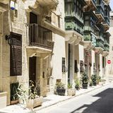 Street on the island of Malta. Typical narrow street on the island of Malta. Buildings with traditional colorful maltese balconies in historical part of Valletta Royalty Free Stock Images