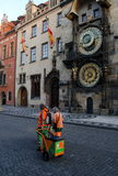 Street janitors on shift near Astronomic clock tower Royalty Free Stock Photo