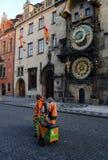 Street janitors on shift near Astronomic clock tower Royalty Free Stock Photo