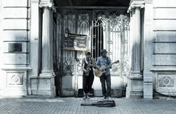Street jazz musicians woman and man. Play a saxophone and guitar in front of a historical old building on Istiklal avenue in Beyoglu Istanbul. The image shows Stock Images