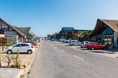 Street of Jeffreys Bay town with surfers shops and cafes royalty free stock photos