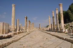 A street in Jerash. A paved street sourrounded by columns in the old roman city of Jerash, Jordan Royalty Free Stock Photos