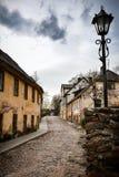 Street in Kandava, Latvia. Streets of Kandava, Latvia. Beautiful old buildings and stone pathway. Kandava is a small town Stock Photo