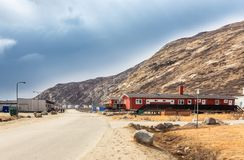 Street in Kangerlussuaq settlement with small living houses amon Stock Images