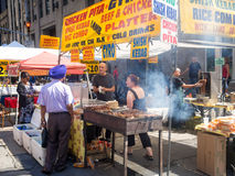Street kiosk selling ethnic food in New York Royalty Free Stock Photography
