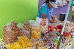 Street kitchen in Ecuador, Equatorians sell food, national snacks from corn, grill, popcorn, fried corn. Fried bananas stock images