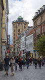 Street Kobmagergade and a round tower Stock Photography
