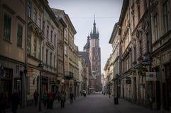Street in Krakow. Church of the Virgin Mary (Kosciol Mariacki) in Krakow, street view Royalty Free Stock Photo