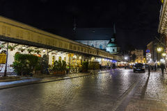 Street in Krakow by night stock photos