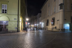 Street in Krakow by night royalty free stock photography