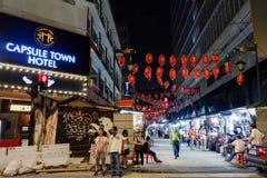 Street at Kuala Lumpur MALAYSI. KUALA LUMPUR MALAYSI people on the street of Kuala Lumpur Chinatown in Kuala Lumpur Malaysia Stock Image
