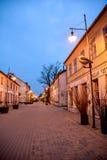 Street in Kuldiga, Latvia. Street of Kuldiga, Latvia at dusk. Dark blue skies, lanterns with no people Stock Photos