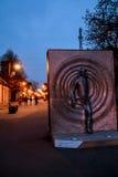 Street in Kuldiga, Latvia. Street of Kuldiga, Latvia at dusk. Dark blue skies, lanterns and statue Stock Photography