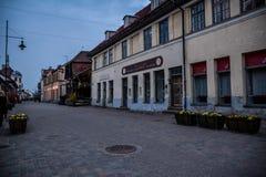 Street in Kuldiga, Latvia. Street of Kuldiga, Latvia at dusk. Dark blue skies, nice buildings, lanterns, no people Stock Photos
