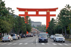 Street in Kyoto, Japan. Cars run on street in Kyoto, Japan. With its 2,000 religious places – 1,600 Buddhist temples and 400 Shinto shrines, as well as palaces Royalty Free Stock Images