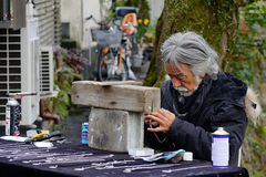 Street in Kyoto, Japan. A man making handicrafts on the street in Kyoto, Japan. Kyoto is well known for its traditional festivals which have been held for over Stock Photo