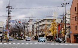 Street in Kyoto, Japan. Vehicles run on the street in Kyoto, Japan. About 20% of Japan's National Treasures and 14% of Important Cultural Properties exist in the Royalty Free Stock Images