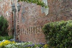 Street Lamb next to a brick wall Royalty Free Stock Image