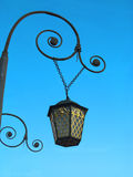 Street lamp. Pendant street lantern with a gold ornament Royalty Free Stock Photos