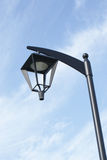 Street Lamp. A street lamp with blue sky and clouds as background Stock Images