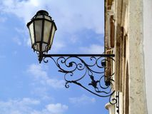 Street Lamp. Old portuguese street lamp with decorative iron holder Stock Photography