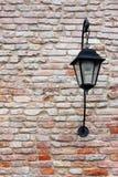 Street lamp. On a textured brick wall of Venice Stock Photos