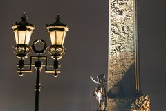 Street lamp. With stele bayonet at background. Night, Russia, Moscow, Park of Victory in memory of second world war Stock Photography