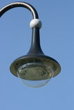 Street lamp. With a large screen, blue sky in the background Royalty Free Stock Image