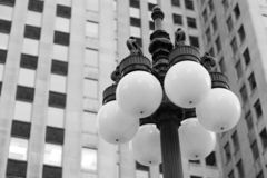Street Lamp. With Glass and Concrete Building in the Background Stock Photos