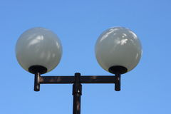 Street lamp. A street lamp with two large, spherical glass body Royalty Free Stock Photography
