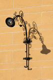 Street lamp. Old street lamp on orange wall stock photography