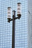 Street lamp against the facade of a modern skyscraper Stock Photo