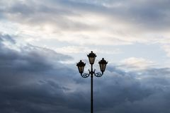 Street lamp against the sky and clouds. Silhouette Royalty Free Stock Image