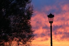Street lamp against the sky at sunset. stock photo