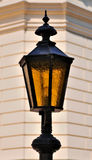Street lamp. Ancient lamp street lighting on the background wall royalty free stock photos