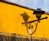 Street Lamp in Antigua, Guatemala. Street Lamp and Colorful Wall in Antigua, Guatemala royalty free stock photo