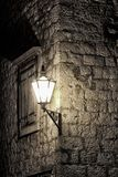 Street lamp on antique wall. Stock Photos