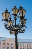 Street lamp on the background of old buildings Stock Photo