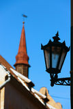 Street lamp on the background of the spire of the building with Stock Photos
