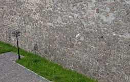 Street lamp on the background of a stone wall Royalty Free Stock Photography