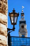 Street lamp on the background of the Town Hall tower Stock Images