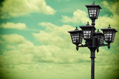 Street lamp on background in vintage style. Stock Images