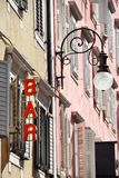 Street lamp and bar sign Royalty Free Stock Photography