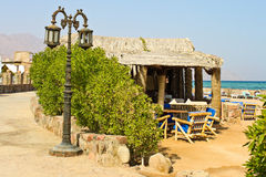 Street lamp and beach cafe near Red sea Royalty Free Stock Image