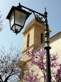 Street lamp and belfry Royalty Free Stock Image