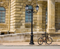 Street lamp and bicycle Stock Images