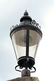 Street lamp. Black painted Street lamp with ornate detailing Royalty Free Stock Image